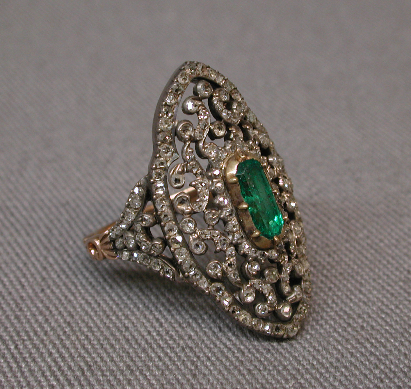 Diamond filigree ring with emerald in the center