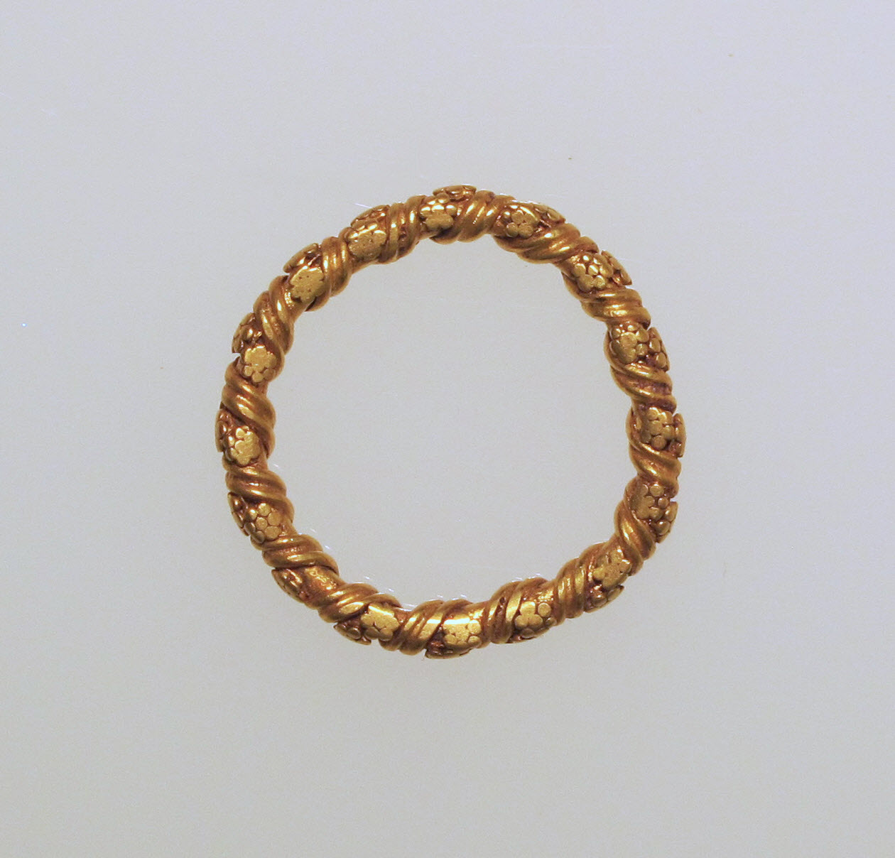 gold ring with twisted design